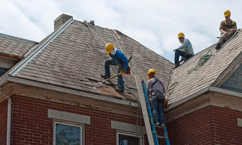 Roofers Repairing Roof