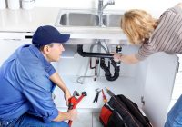 Plumber with customer